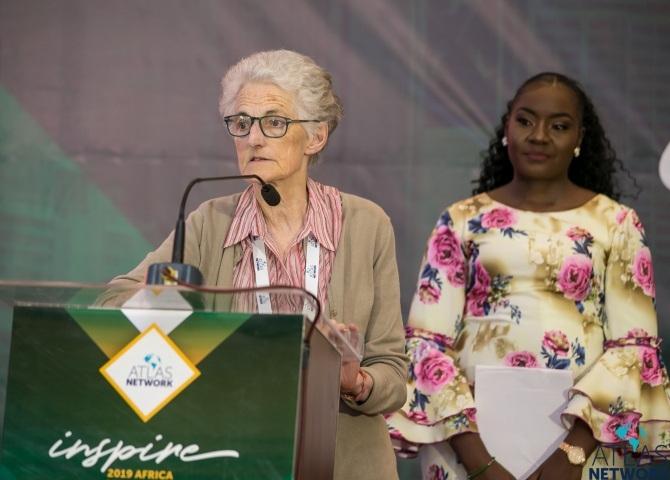 A elderly woman gives a speech at the Africa Liberty Forum.