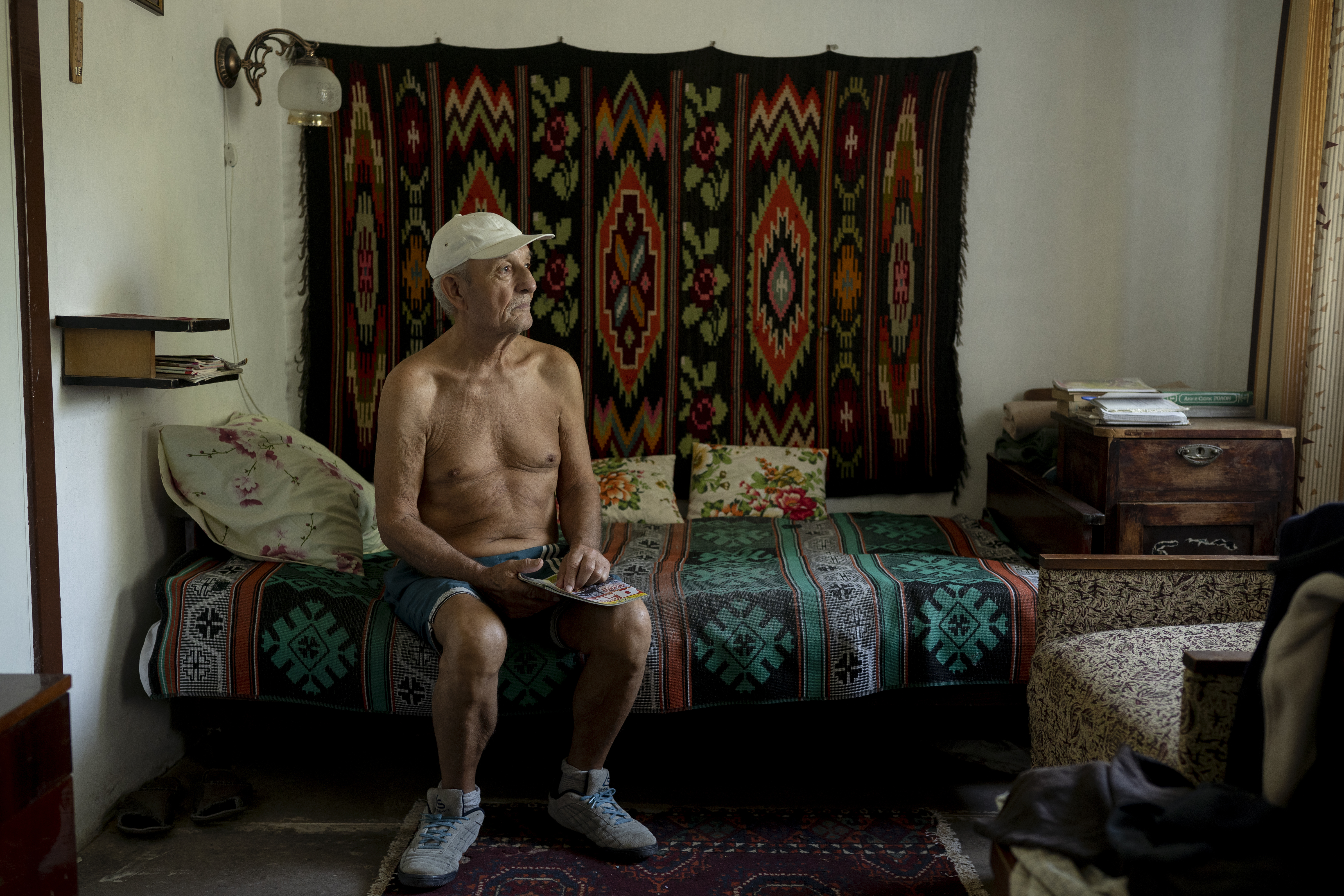 Viktor rests at his dacha after a peaceful morning enjoying fresh fruits and vegetables with his wife Lubov (AtlasNetwork.org Photo/Bernat Parera).