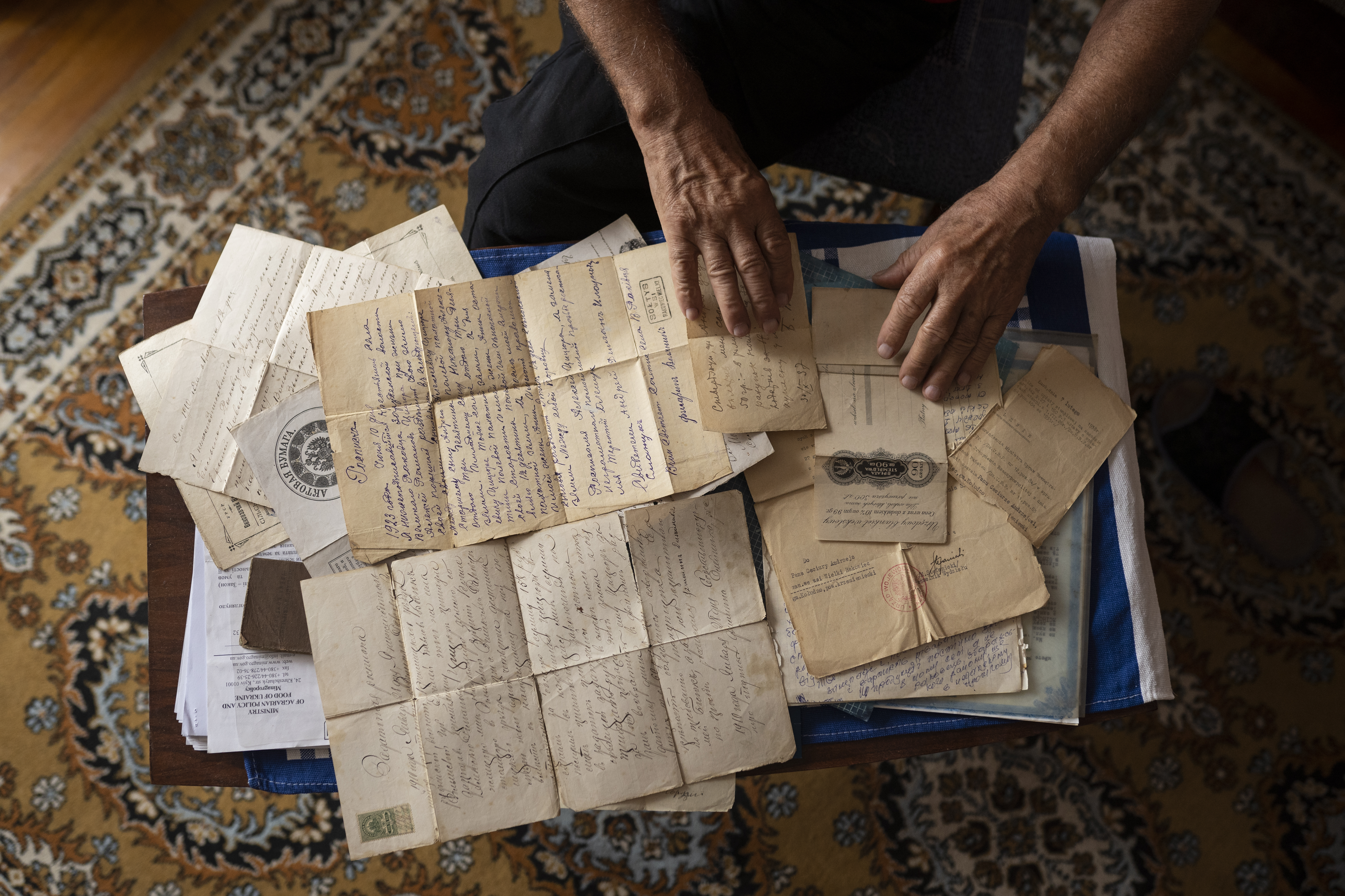 Viktor looks through personal family papers dating back to the 19th century (AtlasNetwork.org Photo/Bernat Parera).