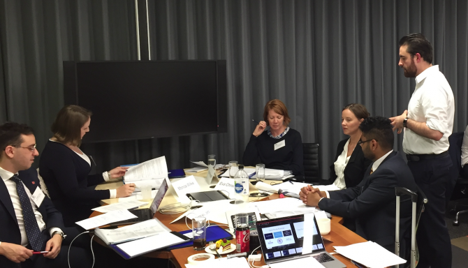 Monica Wilkie opposite Vale Sloane at a conference table.