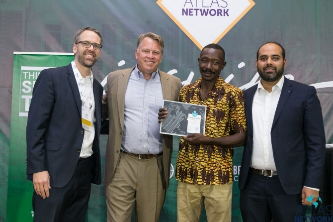 Atlas Network CEO Brad Lips poses with three men at the Africa Liberty Forum.