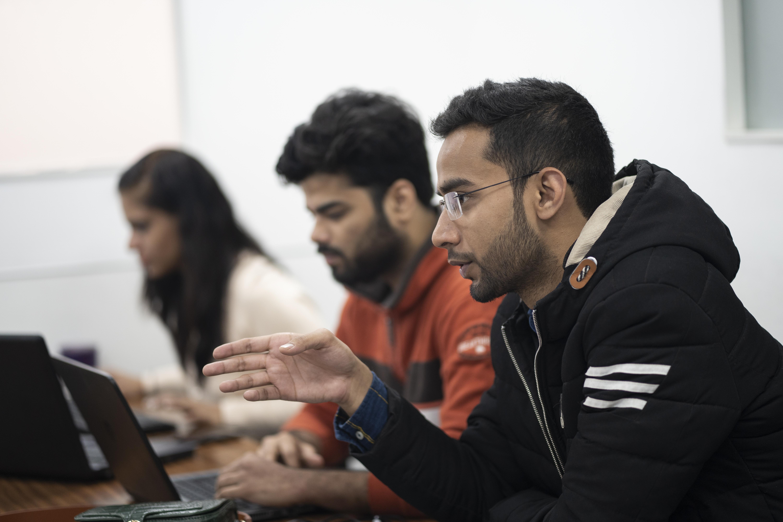 Zubair leads a meeting of his staff at the AddtoGoogle office in Nehru Place (AtlasNetwork.org Photo/Bernat Parera).
