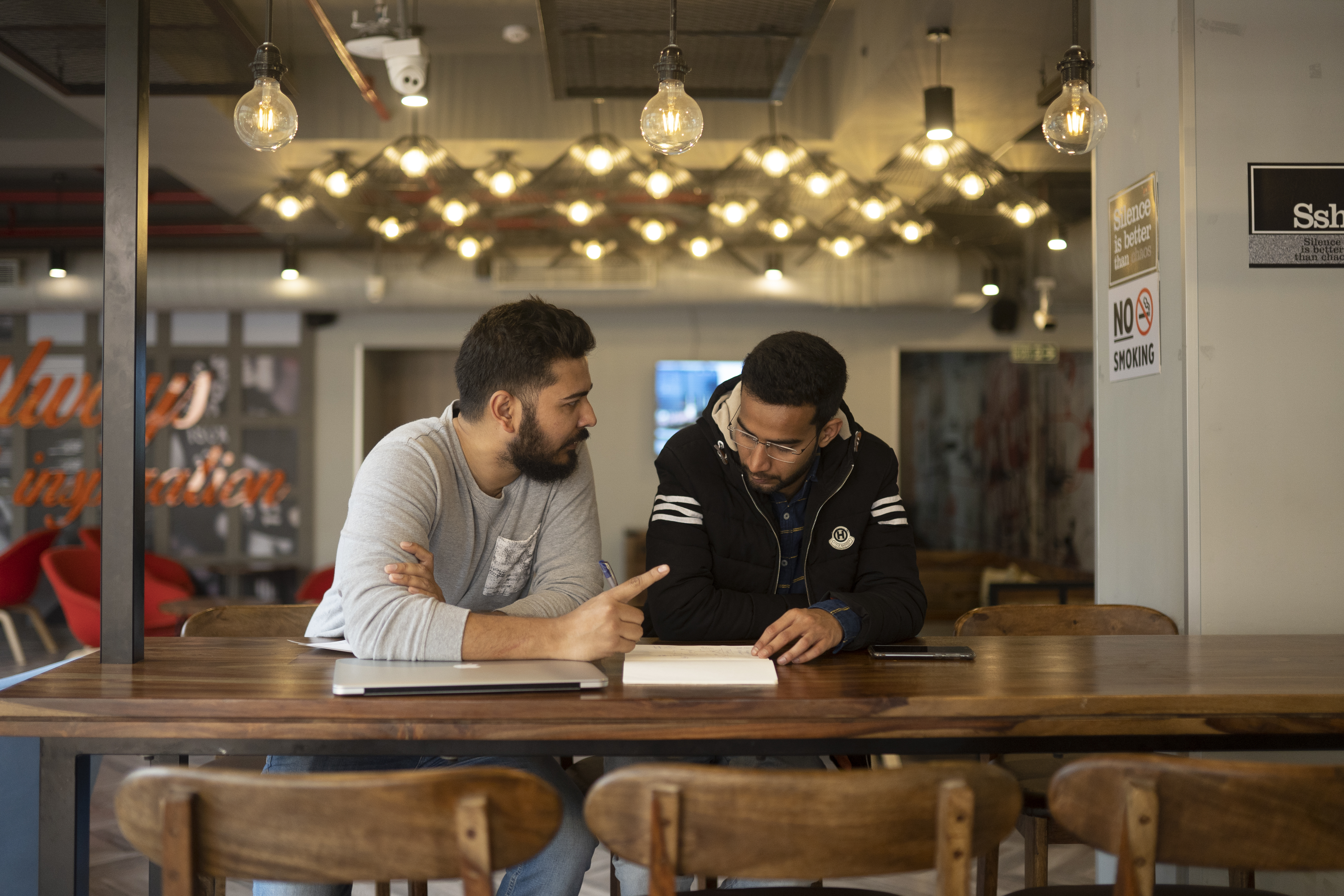 Zubair meets with his business partner Suarav Mahta at the AddtoGoogle office in Nehru Place, New Delhi, India (AtlasNetwork.org/Bernat Parera).
