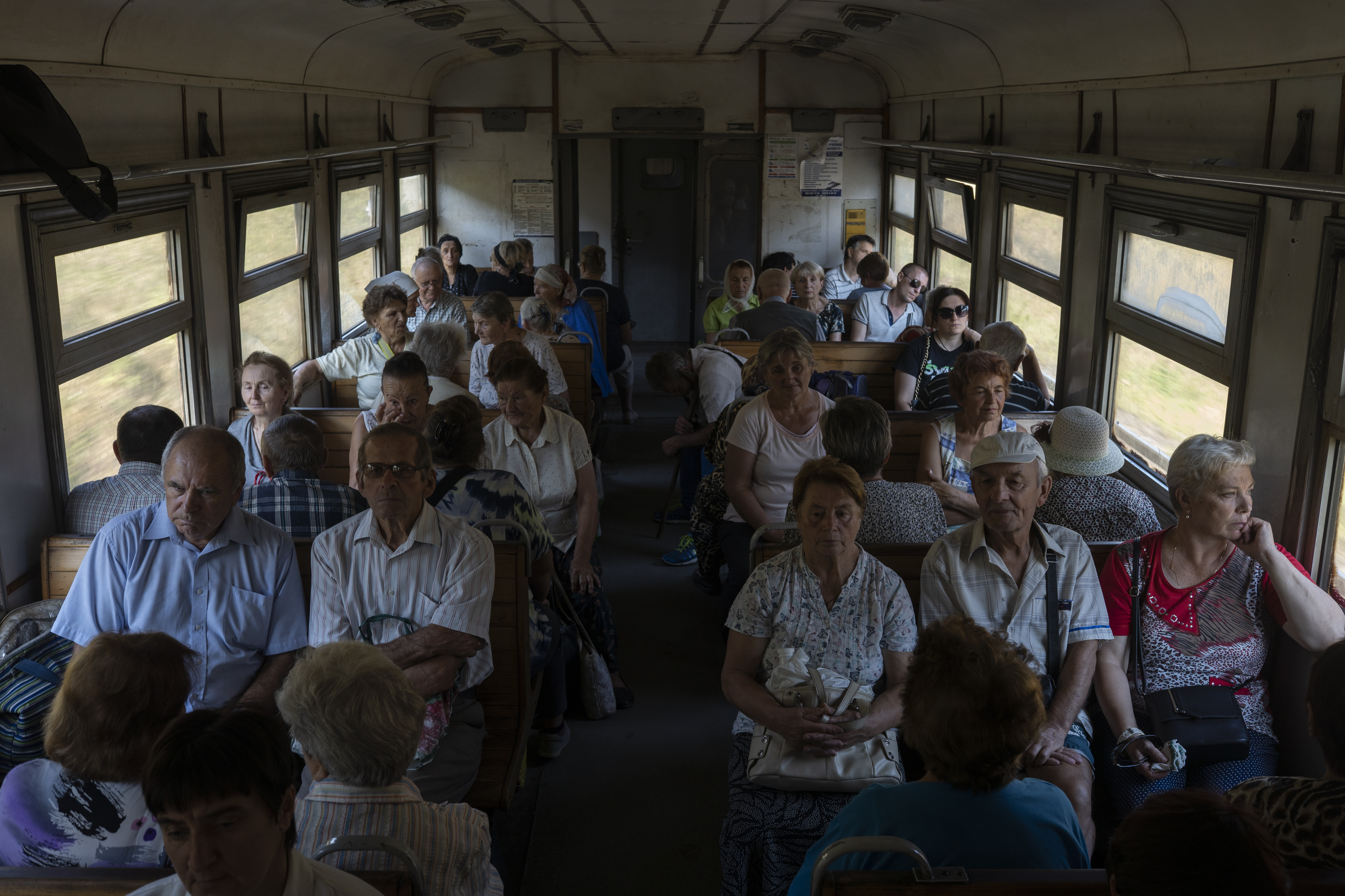 It is not uncommon to have small countryside homes for those who live in apartments in the city. Viktor and Lubov (front right) take a train from Ternopil to their dacha (AtlasNetwork.org Photo/Bernat Parera).