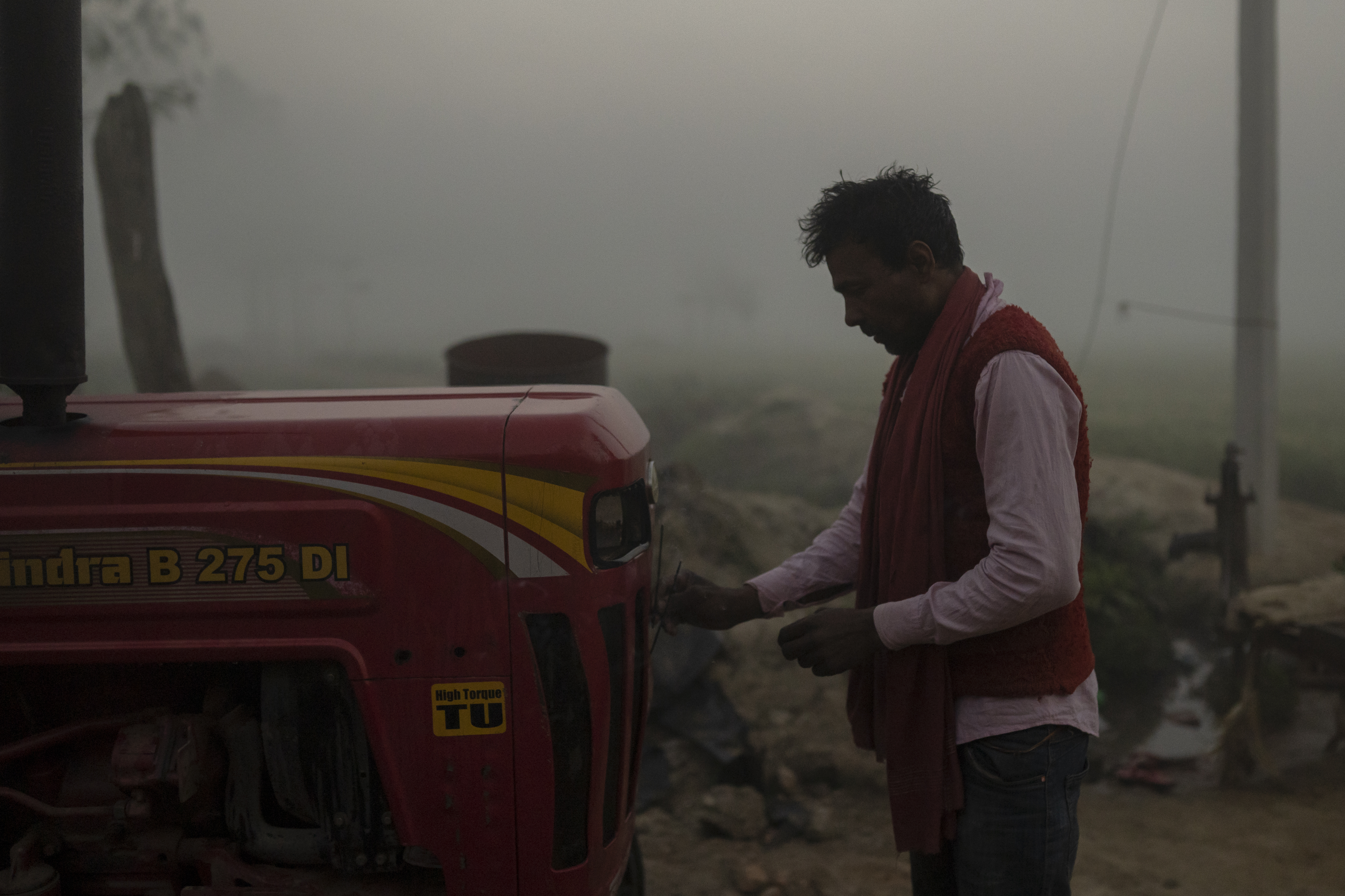 Making offerings to machines is a sign of respect to the deity Biswakarma (the Hindu architect god) in this part of Nepal. Lorik burns incense near his tractor early in the morning before he begins work. (AtlasNetwork.org Photo / Bernat Parera)