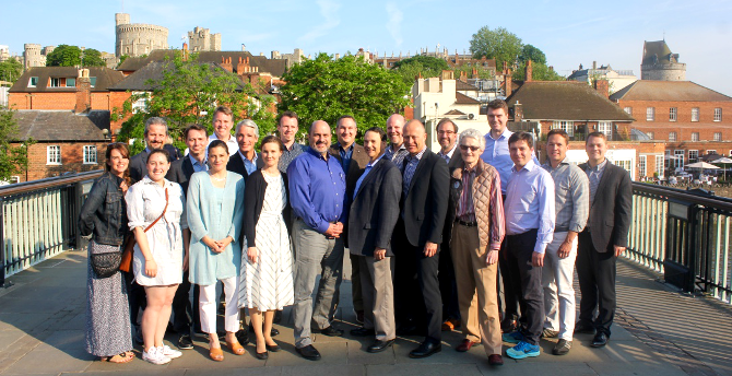 CEO Summit participants and Atlas Network staff gather for a group photo on the footbridge connecting Eaton and Windsor.