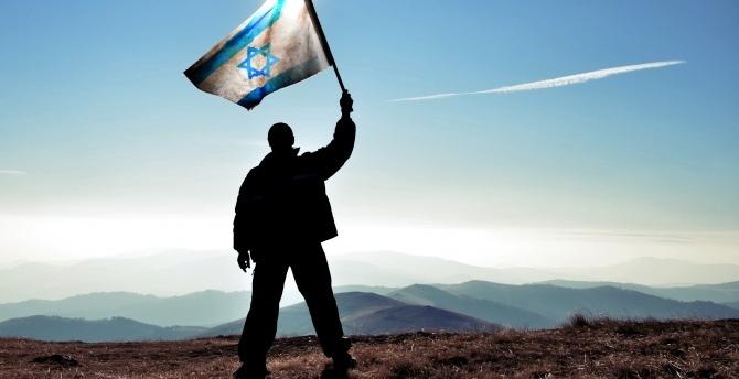 Man waves Israel flag