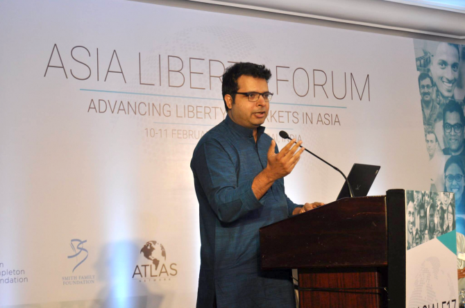 A man speaks on stage at the Asia Liberty Forum.