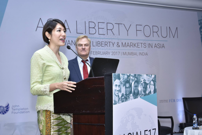 A woman delivers a speech at the Asia Liberty Forum.