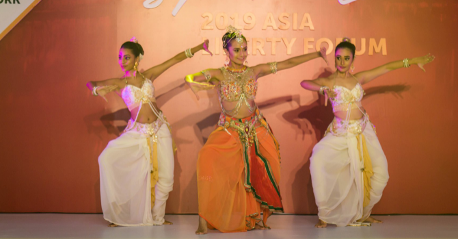 Three female dancers onstage.