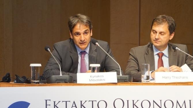 Kyriakos Mitsotakis speaks as Harry Theohans sits beside him listening.