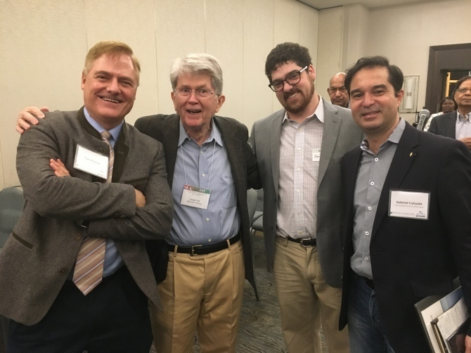 A group of men posses for a photo at an Atlas Network event.