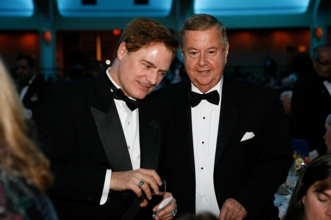 Two men, Palmer and Smith, wearing tuxedo's at an awards banquet.