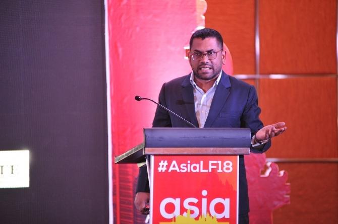 Rangaraju on stage speaking at the 2018 Asia Liberty Forum.