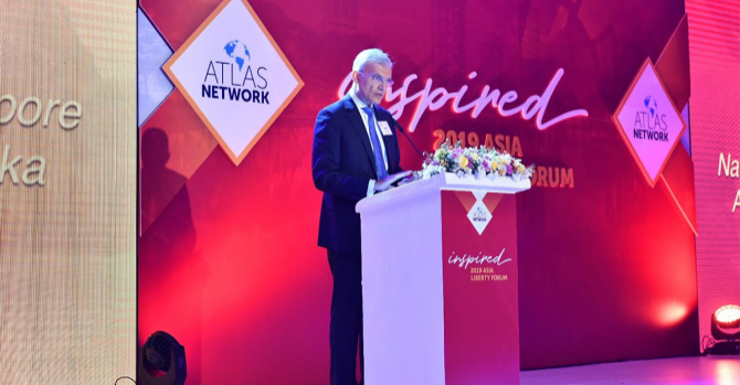A man on stage at the Atlas Network 2019 Asia Liberty Forum.
