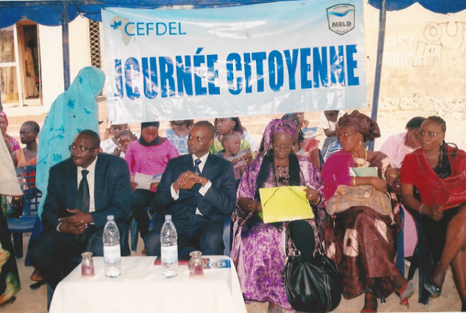 A group watches at an event in Senegal.