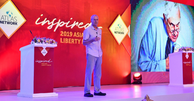 Spencer on stage at the 2019 Asia Liberty Forum.