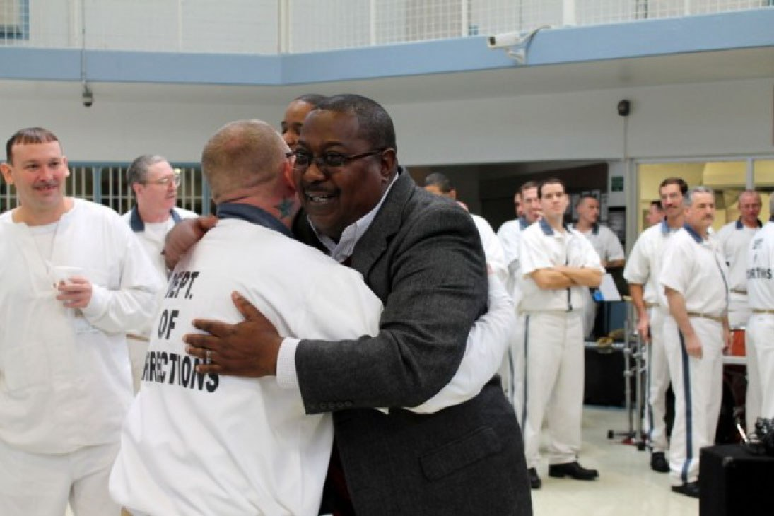 Former inmate Tony Kitchens celebrates 30 years of successful reintegration with residents of Walker Faith and Character-based Prison in Rock Spring, GA.
